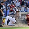 Photo - San Diego Padres' Cameron Maybin, center, raises his arms at home with the winning run as Arizona Diamondbacks catcher Miguel Montero, right, is too late to make a tag and home plate umpire is David Rackley watches in the bottom of the ninth inning of a baseball game on Sunday, May 4, 2014, in San Diego.  The Padres won 4-3. (AP Photo/Lenny Ignelzi)