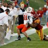 Photo - Iowa State's Bailey Johnson (85) is called for a horse collar tackle of Zac Robinson (1) in the second half during the college football game as the Oklahoma State University (OSU) Cowboys play the Iowa State University (ISU) Cyclones at Jack Trice Stadium on Saturday, November 7, 2009, in Ames, Iowa. Photo by Steve Sisney, The Oklahoman ORG XMIT: KOD