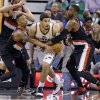 Photo - Portland Trail Blazers' Damian Lillard, left, and Wesley Matthews (2) defends against Utah Jazz's Enes Kanter, center, in the fourth quarter of an NBA basketball game on Friday, April 11, 2014, in Salt Lake City. (AP Photo/Rick Bowmer)