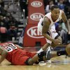 Photo - Atlanta Hawks guard Jeff Teague (0) comes up with a loose ball against Miami Heat guard Norris Cole (30) in the first half of an NBA basketball game, Wednesday, Feb. 20, 2013, in Atlanta. (AP Photo/John Bazemore)