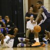 Orlando Magic\'s Doron Lamb (1) passes the ball as he falls backward past Oklahoma City Thunder\'s Dwight Bucks, right, during an NBA summer league basketball game, Monday, July 8, 2013, in Orlando, Fla. (AP Photo/John Raoux) ORG XMIT: DOA105