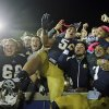 Photo -   In this Sept. 22, 2012 photo, Notre Dame's Chris Watt (66), Manti Te'o (5) and TJ Jones (7) celebrate with fans after Notre Dame defeated Michigan, 13-6, in an NCAA college football game in South Bend, Ind. Notre Dame defensive coordinator Bob Diaco believes Manti Te'o is the finest football player in college. (AP Photo/Darron Cummings)