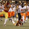 Oklahoma State\'s\' Tracy Moore (87) runs past Iowa State\'s C.J. Morgan (27) and ITer\'Ran Benton (22) during a college football game between the Oklahoma State University Cowboys (OSU) and the Iowa State University Cyclones (ISU) at Jack Trice Stadium in Ames, Iowa, Friday, Nov. 18, 2011. Photo by Bryan Terry, The Oklahoman