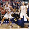 Oklahoma\'s Morgan hook goes past west Virginia\'s Darius Faulk during the Big 12 tournament women\'s college basketball game between the University of Oklahoma and West Virginia at American Airlines Arena in Dallas, Saturday, March 9, 2012. Photo by Bryan Terry, The Oklahoman