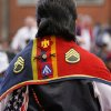 The shawl worn by Bruce Ceasar has his military patches attached to it, At least 500 people representing several dozen Native American Nations within the state attended a New Year\'s pow-wow in the Centennial Building at State Fair Park Saturday , January 7, 2012, The celebration started around shortly after noon and continued into the night. Several hundred took part in the various dancers and the dancers wore tribal regalia. Photo by Jim Beckel, The Oklahoman