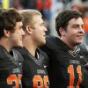 Oklahoma State\'s Wes Lunt (11), right, sings the alma mater along with Alex Elkins (37), left, and Zac Veatch (86) after a college football game between Oklahoma State University (OSU) and Texas Christian University (TCU) at Boone Pickens Stadium in Stillwater, Okla., Saturday, Oct. 27, 2012. OSU won, 36-14. Photo by Nate Billings, The Oklahoman
