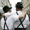 Photo - FILE - In this Aug. 12, 2006 file picture participants of the Christopher Street Day dressed in typically Bavarian clothes walk embraced during the parade through the city of Munich, southern Germany. Gay rights campaigners won a victory in Germany on Thursday June 6, 2013 when the country's top court ordered the government to grant homosexual civil unions the same tax benefits as heterosexual married couples. The Federal Constitutional Court in Karlsruhe ruled that treating the two forms of partnership differently for tax purposes violates the country's guarantee of equal rights.  (AP Photo/Christof Stache,File)