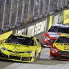 Photo - Matt Kenseth (20) and Joey Logano (22) battle for the lead as Brad Keselowski (2) trails during a NASCAR Sprint Cup Series auto race at Bristol Motor Speedway on Saturday, Aug. 23, 2014, in Bristol, Tenn. (AP Photo/Wade Payne)