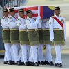 Photo - Malaysian Army soldiers carry a coffin containing the body of Mohd Ghafar Abu Bakar, a Malaysia Airlines in-flight supervisor who was among the victims onboard Flight MH17, upon arrival at Kuala Lumpur International Airport in Sepang, Malaysia, Sunday, Aug. 24, 2014. (AP Photo/Lai Seng Sin)