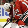 Chicago Blackhawks\' Jonathan Toews, right, and Phoenix Coyotes\' Antoine Vermette battle for the puck during the second period of an NHL hockey game in Chicago, Thursday, Nov. 14, 2013. (AP Photo/Nam Y. Huh)