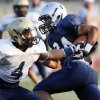 Edmond North\'s Ezel McIntee (24) avoids Southmoore\'s Johnathan Martin (4) during a high school football scrimmage at Moore Stadium in Moore, Okla., Friday, Aug. 17, 2012. Photo by Nate Billings, The Oklahoman