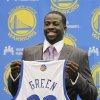 Golden State Warriors third draft pick Draymond Green, a forward from Michigan State, holds up his new jersey during a news conference at Warriors headquarters in Oakland, Calif., Monday, July 2, 2012. (AP Photo/Paul Sakuma)