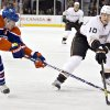 Photo - Anaheim Ducks' Corey Perry (10) battles with against Edmonton Oilers' Ladislav Smid during the first period of their NHL hockey game in Edmonton, Alberta, Sunday, April 21, 2013. (AP Photo/The Canadian Press, Jason Franson)