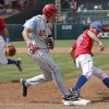 Oklahoma\'s Hector Lorenzana (12) is tagged out at first by Kansas\' Jordan Piche\' (45) in the Big 12 Championship baseball game between the University of Kansas Jayhawks (KU) and the University of Oklahoma Sooners (OU) at the Chickasaw Bircktown Ballpark on Sunday, May 26, 2013 in Oklahoma City, Okla. Photo by Chris Landsberger, The Oklahoman