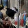 In this Wednesday, March 27, 2013 image taken from video obtained from the Shaam News Network, which has been authenticated based on its contents and other AP reporting, a wounded Syrian man receives treatment at a hospital in Daraa, Syria. (AP Photo/Shaam News Network via AP video)