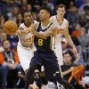 Photo - Utah Jazz guard Diante Garrett (8) passes as Phoenix Suns guard Eric Bledsoe, left, and Goran Dragic, of Slovenia, look on during the first half of an NBA basketball game on Saturday, Nov. 30, 2013, in Phoenix. (AP Photo/Matt York)
