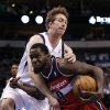 Dallas Mavericks\' Troy Murphy (6) wraps up and stops Washington Wizards\' Martell Webster (9) on a break away drive to the basket in the first half of an NBA basketball game, Wednesday, Nov. 14, 2012, in Dallas. (AP Photo/Tony Gutierrez)