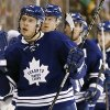 Toronto Maple Leafs\' Nikolai Kulemin is congratulated on his goal at the bench by teammates after scoring against the Boston Bruins during the second period of an NHL hockey game in Boston Monday, March 25, 2013. (AP Photo/Winslow Townson)