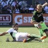 Photo - Seattle Sounders' Andy Rose, right, vies for control of the ball against Portland Timbers' Norberto Paparatto, left, during an MLS soccer game in Portland, Ore., Sunday, Aug. 24, 2014. (AP Photo/Natalie Behring)
