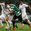 Photo - Sporting's Montero, from Colombia, center, challenges the Academica defense during their Portuguese league soccer match Sunday, Feb. 2 2014, at Sporting's Alvalade stadium in Lisbon. (AP Photo/Armando Franca)