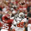 Damian Davis of OSU catches the ball in front of D.J. Wolfe of OU during the first half of the college football game between the University of Oklahoma Sooners (OU) and the Oklahoma State University Cowboys (OSU) at the Gaylord Family-Memorial Stadium on Saturday, Nov. 24, 2007, in Norman, Okla. Photo By Bryan Terry, The Oklahoman