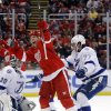 Photo - Detroit Red Wings' David Legwand, center, celebrates his goal against Tampa Bay Lightning's Ben Bishop (30) and Victor Hedman (77), of Sweden, during the second period of an NHL hockey game, Sunday, March 30, 2014, in Detroit. (AP Photo/Duane Burleson)