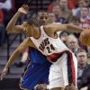 Portland Trail Blazers guard Andre Miller (24) drives on Oklahoma City Thunder guard Russell Westbrook during the first half of an NBA basketball game in Portland, Ore., Tuesday, Feb. 9, 2010. AP PHOTO