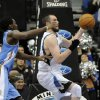Minnesota Timberwolves\' Kevin Love, right, receives a pass before being fouled by Denver Nuggets\' Kenneth Faried, left, in the second half of an NBA basketball game on Wednesday, Nov. 21, 2012, in Minneapolis. The Nuggets won 101-94. Love led the Timberwolves with 34 points and 14 rebounds while Faried had 14 rebounds for the Nuggets. (AP Photo/Jim Mone)