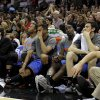 Oklahoma City\'s Daequan Cook, left, Thabo Sefolosha, Kendrick Perkins, and Nick Collison sit on the bench as the San Antonio crowd cheers during Game 2 of the Western Conference Finals between the Oklahoma City Thunder and the San Antonio Spurs in the NBA playoffs at the AT&T Center in San Antonio, Texas, Tuesday, May 29, 2012. Oklahoma City lost 120-111. Photo by Bryan Terry, The Oklahoman