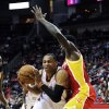 Oklahoma City Thunder\'s Russell Westbrook, left, tries to get past Houston Rockets\' Patrick Beverley in the first half of an NBA basketball game, Wednesday, Feb. 20, 2013, in Houston. (AP Photo/Pat Sullivan)