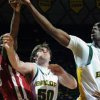 Baylor\'s Ekpe Udoh, right, reaches for a loose rebound against Oklahoma\'s Willie Warren, left, in the first half of an NCAA college basketball game Saturday, Jan. 9, 2010, in Waco, Texas. Looking on for Baylor is Josh Lomers (50). (AP Photo/Waco Tribune Herald, Rod Aydelotte)