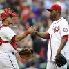 Photo - Washington Nationals relief pitcher Rafael Soriano, right, celebrates a 5-4 win over the Detroit Tigers with catcher Wilson Ramos, left, in a baseball game, Thursday, May 9, 2013, in Washington. (AP Photo/Nick Wass)