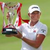 Stacy Lewis of the United States poses with the challenge trophy after winning the HSBC Women\'s Champions golf tournament on Sunday, March 3, 2013 in Singapore. (AP Photo/Wong Maye-E)