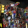 Supporters of President Hugo Chavez celebrate outside the Miraflores presidential palace in Caracas, Venezuela, Sunday, Oct. 7, 2012. Venezuela\'s electoral council said late Sunday President Hugo Chavez has won re-election, defeating challenger Henrique Capriles.(AP Photo/Ramon Espinosa)