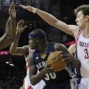 Memphis Grizzlies\' Zach Randolph (50) is surrounded by Houston Rockets\' James Harden and Omer Asik (3) in the first half of an NBA basketball game on Saturday, Dec. 22, 2012, in Houston. (AP Photo/Pat Sullivan)