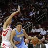 Denver Nuggets\' Danilo Gallinari (8) drives the ball around Houston Rockets\' Chandler Parsons, left, in the first half of an NBA basketball game Wednesday, Jan. 23, 2013, in Houston. (AP Photo/Pat Sullivan)
