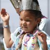 OK Indian Nation Tiny Tot, Danyella Redshin, waves to the crowd during the Red Earth parade in downtown Oklahoma City on June 7, 2013. Photo by Aliki Dyer, The Oklahoman