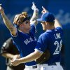 Photo -   Toronto Blue Jays third baseman Brett Lawrie, left, celebrates with teammate Adam Lind, right, after defeating the Boston Red Sox 5-0 in a baseball game in Toronto on Sunday, Sept. 16, 2012. (AP Photo/The Canadian Press, Nathan Denette)
