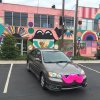 Photo - A car outfitted with one of the Lyft ride-sharing service's signature pink mustaches is parked outside of Oklahoma City's Womb gallery on NW 9.   Photo provided <strong></strong>