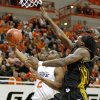 OSU\'s Obi Muonelo goes past Missouri\'s DeMarre Carroll during the Big 12 college basketball game between Oklahoma State and Missouri at Gallagher-Iba Arena in Stillwater, Okla., Wednesday, Jan. 21, 2009. PHOTO BY BRYAN TERRY, THE OKLAHOMAN