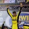 Photo - Matt Kenseth celebrates after winning the NASCAR Sprint Cup Series auto race, Saturday, Aug. 24, 2013, at Bristol Motor Speedway in Bristol, Tenn. (AP Photo/Wade Payne)