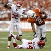 Texas\' Fozzy Whittaker (2) is brought down by Oklahoma\'s Aaron Colvin (14) as Jamell Fleming (32) watches during the Red River Rivalry college football game between the University of Oklahoma Sooners (OU) and the University of Texas Longhorns (UT) at the Cotton Bowl in Dallas, Saturday, Oct. 8, 2011. Oklahoma won 55-17 Photo by Bryan Terry, The Oklahoman