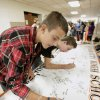 Freshman Tanner Zody, 14, signing his name on a commitment to graduate banner Thursday, Sept. 9, 2010, in Oklahoma City, as Putnam City High School class of 2014 make a commitment to finish high school and graduate. The freshmen signed the commitment banner, tried on caps and gowns and had their pictures taken. Photo by Paul B. Southerland, The Oklahoman