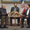Photo -   U.N. envoy on Syria, Lakhdar Brahimi, left, talks with Iranian President Mahmoud Ahmadinejad, during their meeting in Tehran, Iran, Sunday, Oct. 14, 2012. An unidentified interpreter sits at center. (AP Photo/ISNA, Amir Pourmand)