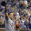 FILE - This Oct. 3, 2012 file photo shows Detroit Tigers\' Miguel Cabrera waving to the crowd after being replaced during the fourth inning of a baseball game against the Kansas City Royals at Kauffman Stadium in Kansas City, Mo. His achievements have made many proud in baseball-loving Venezuela, where he recently won the annual Luis Aparicio Prize, presented to the best Venezuelan major leaguer of the year. (AP Photo/Orlin Wagner, File)