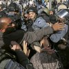 Israeli police and Muslim worshippers who were prevented from entering the Al-Aqsa mosque compound for prayers, scuffle in Jerusalem\'s Old City, Friday, Nov. 16, 2012. Israeli police was on high alert on Friday to prevent clashes following Friday prayers. (AP Photo/Mahmoud Illean),