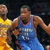 Oklahoma City\'s Kevin Durant (35) dribbles past Los Angeles\' Metta World Peace (15) during Game 3 in the second round of the NBA basketball playoffs between the L.A. Lakers and the Oklahoma City Thunder at the Staples Center in Los Angeles, Friday, May 18, 2012. Photo by Nate Billings, The Oklahoman