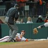 Clemson\'s Garrett Boulware, center, looks up at umpire Jack Cox, left, for the call after being tagged out at third by South Carolina third baseman Chase Vergason in an NCAA college baseball game on Friday, March 1, 2013, in Clemson, S.C. (AP Photo/Anderson Independent-Mail, Mark Crammer) GREENVILLE NEWS OUT, SENECA NEWS OUT