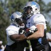 Former OSU linebacker Alex Elkins, right, has a good shot of making the Detroit Lions\' roster, according to some of the team\'s brass. And no, he\'s not converting to running back. He\'s just running a drill with other linebackers. (AP Photo/Paul Sancya)