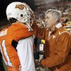 Texas head coach Mack Brown pats OSU quarterback Zac Robsinson (11) on the head after the two talked following the college football game between the Oklahoma State University Cowboys (OSU) and the University of Texas Longhorns (UT) at Boone Pickens Stadium in Stillwater, Okla., Saturday, Oct. 31, 2009. Texas won, 41-14. Photo by Nate Billings, The Oklahoman
